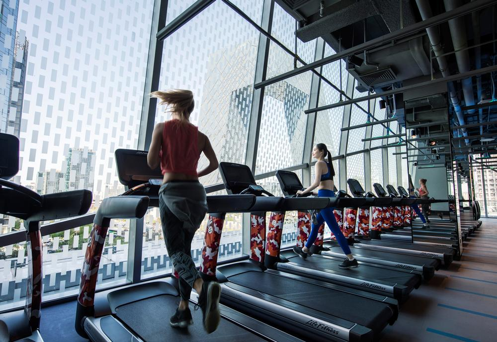 The treadmill cardio space is just one of 11 separate workout zones found in the ultra modern gym