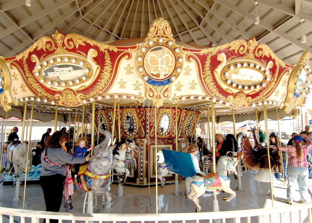 The carousel is sunken so that people in wheelchairs can access it