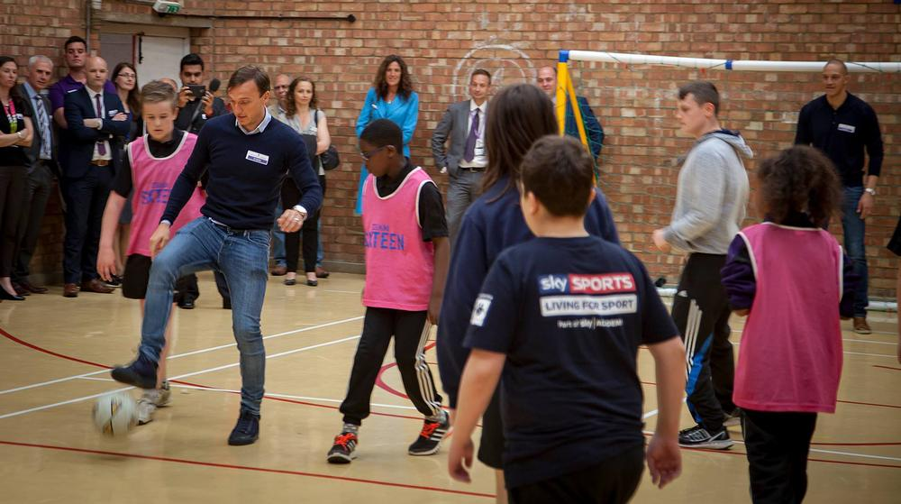 Mark Noble plays a game of football with the kids at Houghton Regis Academy