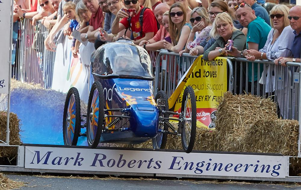 Legend competes in the Annual Micklegate Run Soapbox Race, raising funds for Cancer Research UK