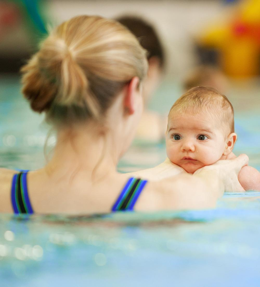 Parents act as assistant teachers during swim sessions
