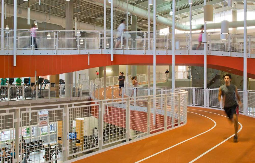 The Recreation and Wellness Center in Auburn, Alabama, US, breaks boundaries with its figure-8, suspended running track and communal spaces