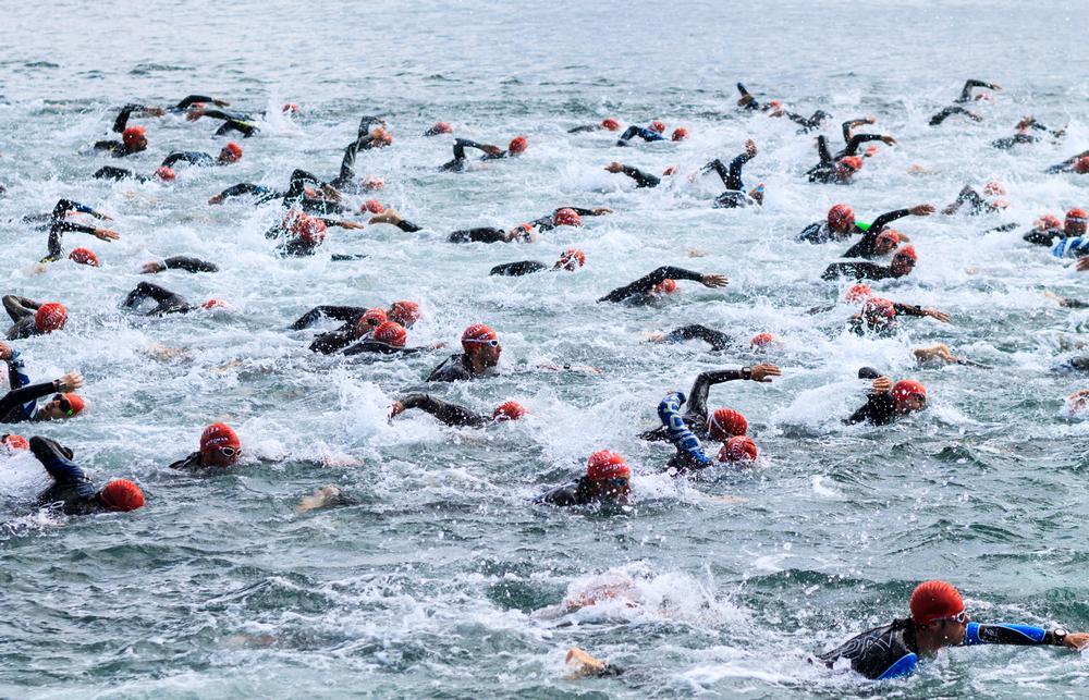 Athletes kick off the swimming leg of the 2016 Laredo Triathlon in northern Spain / PHOTOS: SHUTTERSTOCK.COM