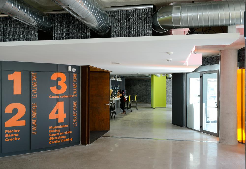 The design features industrial-looking surfaces and exposed pipework,  mixed with flashes of colour