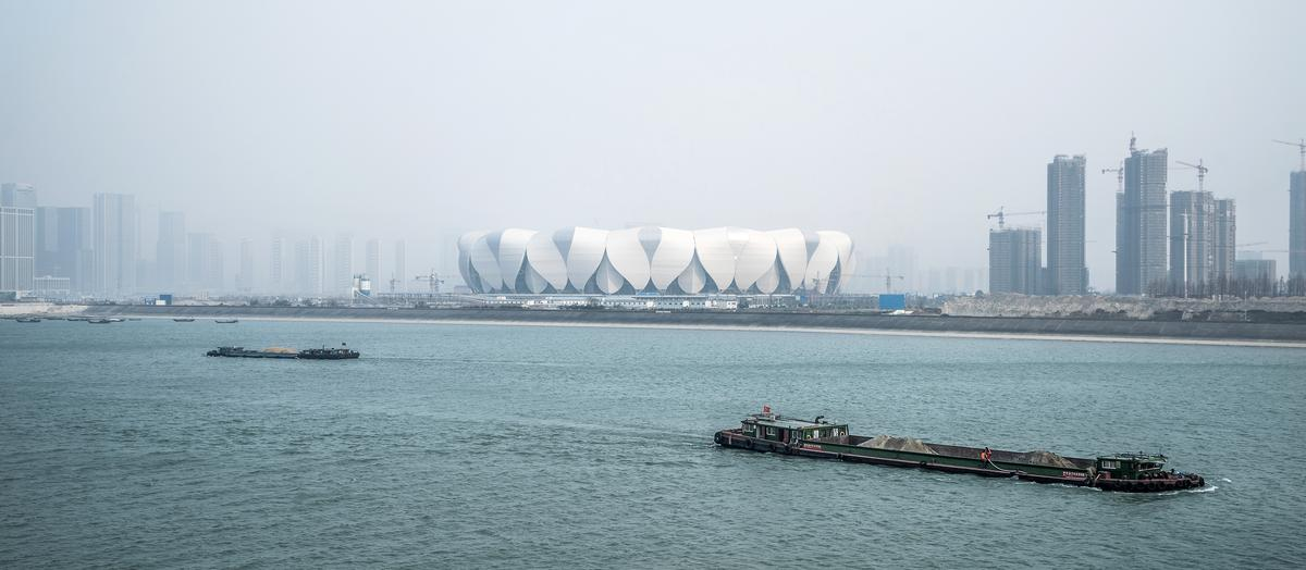 The view of the stadium from the Qian Tang river / NBBJ Design