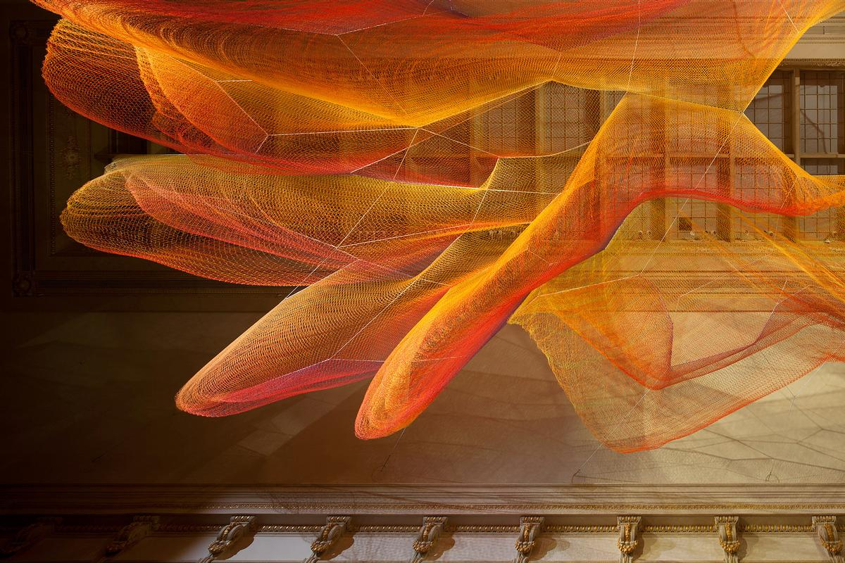 A suspended, handwoven net created by Janet Echelman