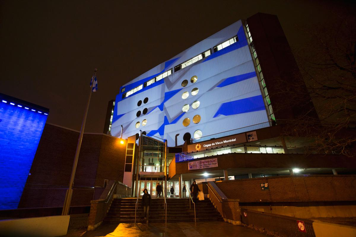 Abstract video projections are displayed on the walls of nine surrounding buildings