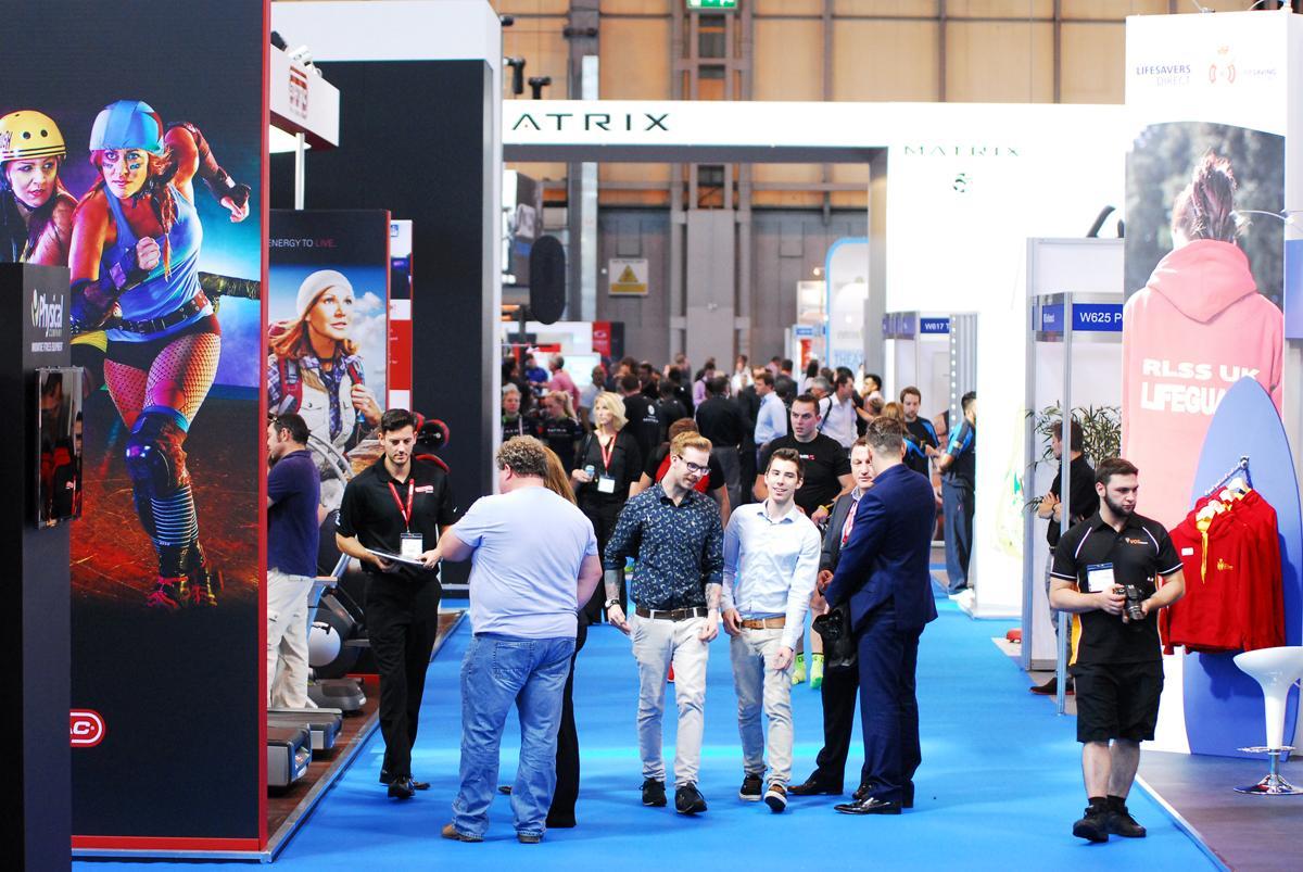 Industry delegates walk around LIW at Birmingham's NEC arena