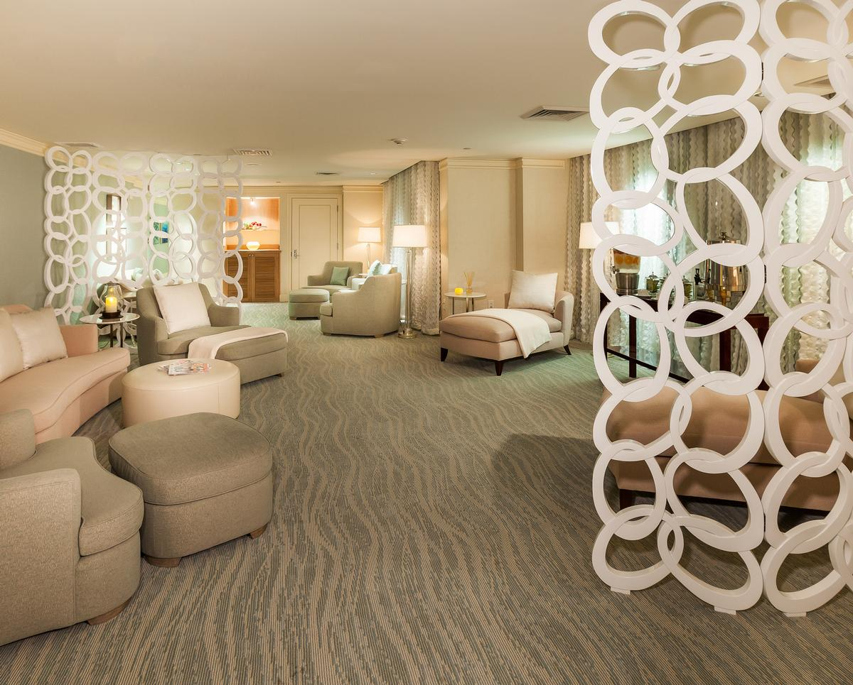 The upgrade spa compliments the aesthetics of the oceanfront with tones of aqua and greens layered into the design / Ritz-Carlton