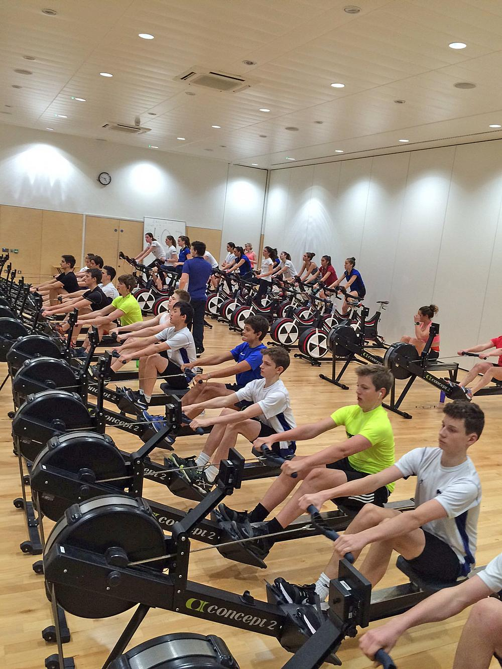 Young rowers at Latymer Upper School train on the erg and the indoor bike