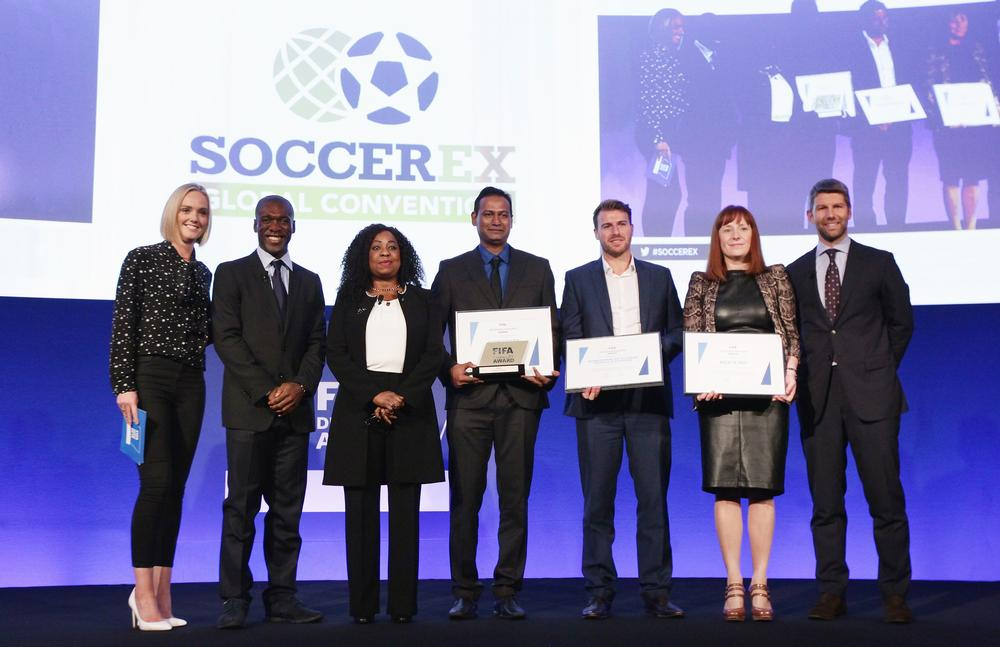 Fatma Samoura (third from left) presents the first FIFA Diversity Award to Indian charity Slum Soccer