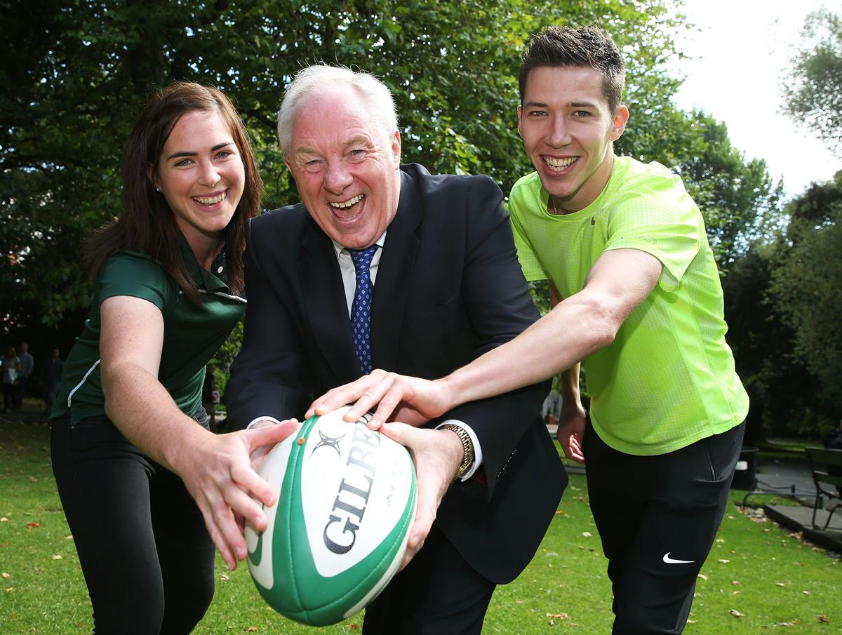 Michael Ring (centre) said he was encouraged by the rate of social sport participation / Press Association