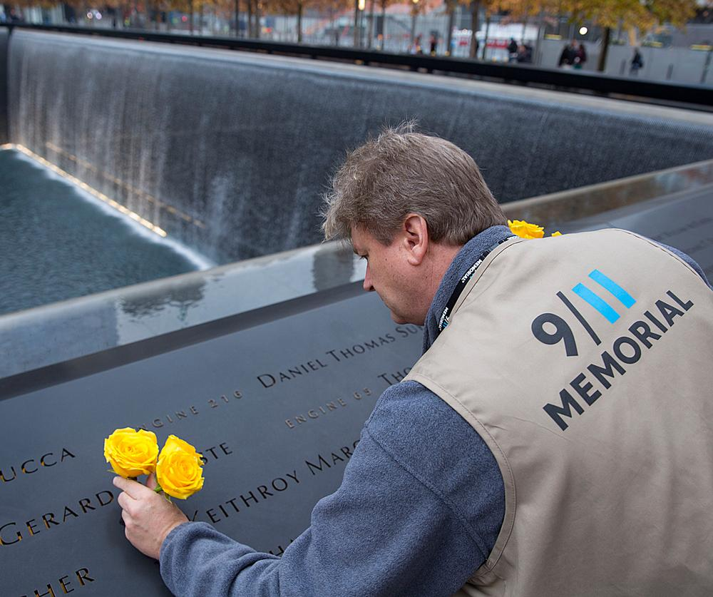 Victims' names carved around the edge of the waterfalls at the Memorial Plaza / this PHOTO & above: © JIN LEE