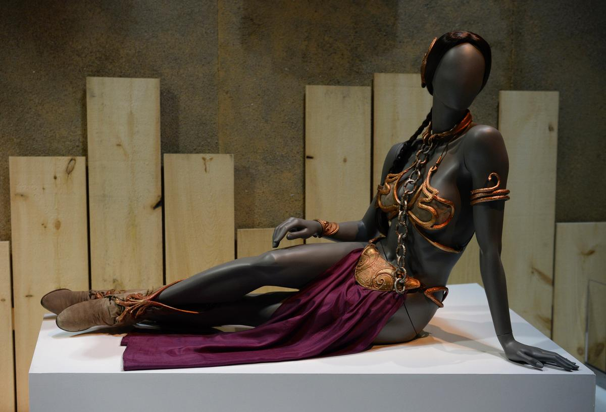 Props used in the movies, such as Princess Leia's slave costume are featured / Discovery Times Square