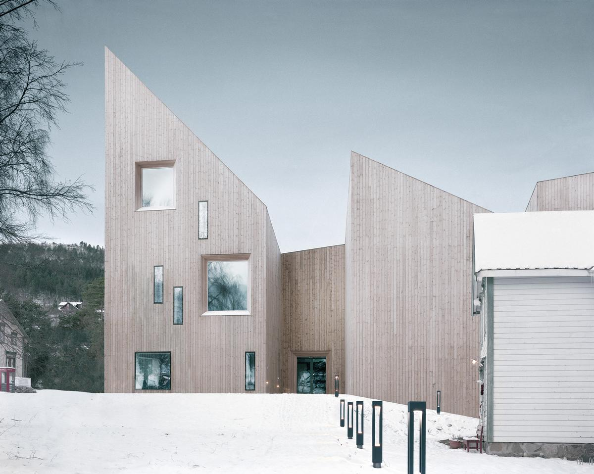 Exterior walls and the roof are made of solid timber and pine, with steel beams only used when required / Reiulf Ramstad Arkitekter