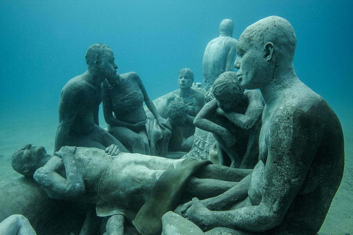 Divers, snorkelers and visitors in glass-bottomed boats will be able to view crowds of motionless human figures sculpted by British artist Jason deCaires Taylor / Jason deCairnes Taylor