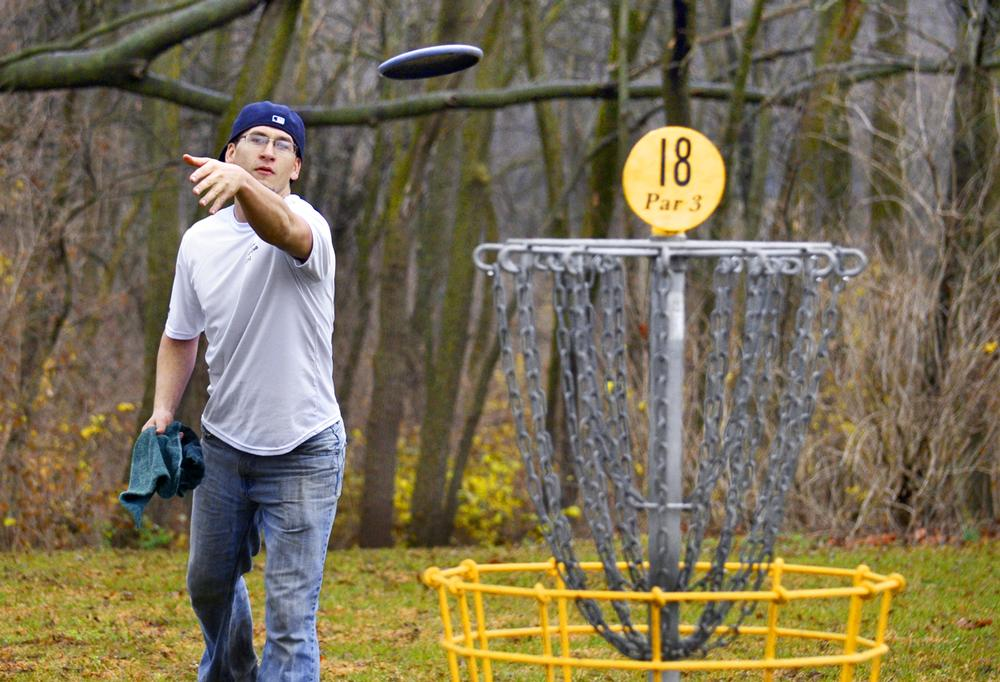 The goal is to get the disc into the cages with as few throws as possible / jeff morehead / press association