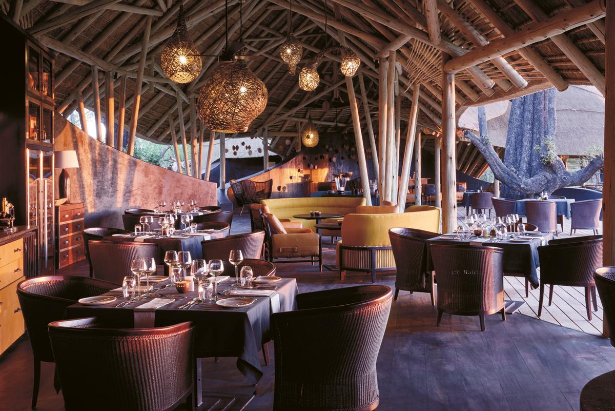 The lodge's public spaces include an arrivals boma, a bar, a restaurant, a library, an internet lounge, a camp fire area and a shop / Belmond Eagle Island Lodge Botswana