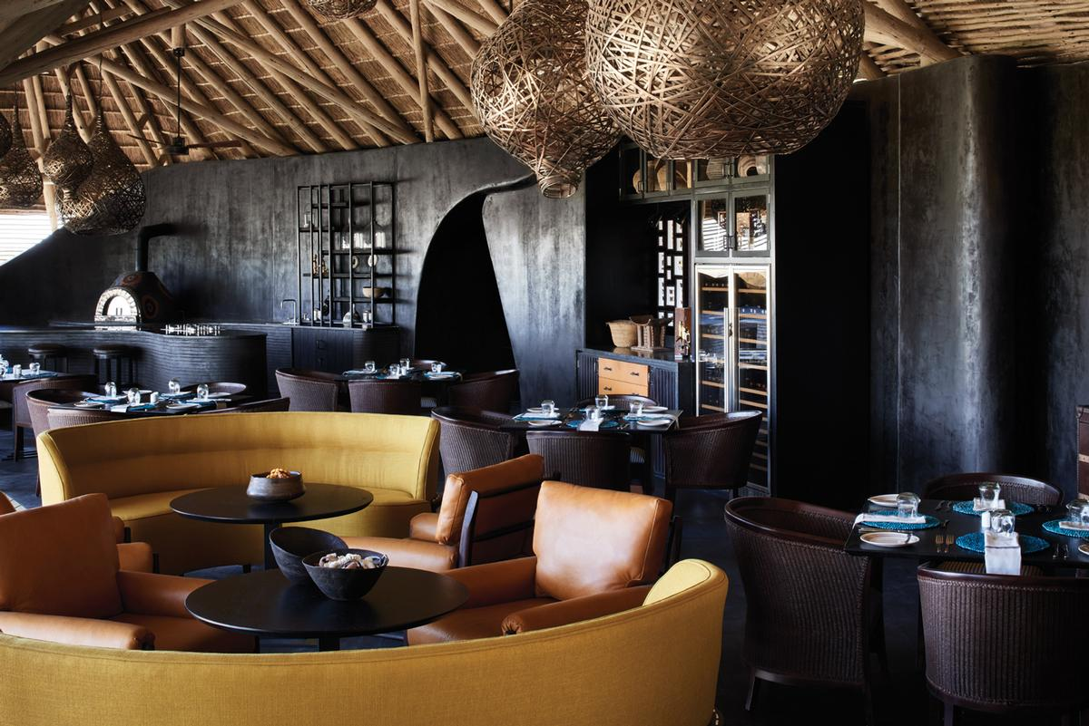 Moore's design mixes traditional art works, nature-inspired sculptures and contemporary features and matierals / Belmond Eagle Island Lodge Botswana