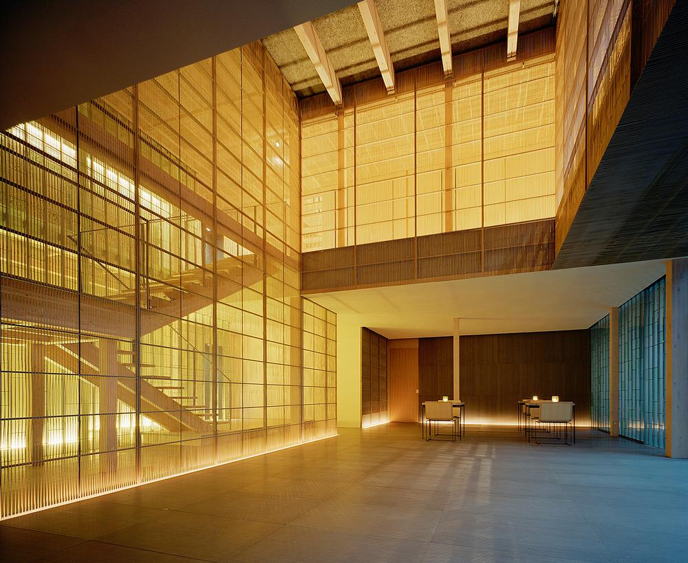 Kengo Kuma's Ginzan Onsen Fujiya features a striking atrium surrounded by a delicate screen made from bamboo / PHOTOS OF GINZAN ONSEN FUJIYA: DAICI ANO