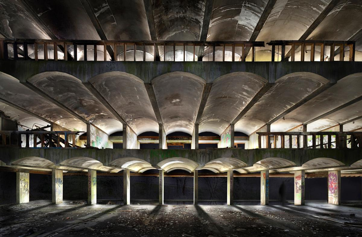 Visitors can walk through the ruined buildings of St Peter's Seminary in Cardross while accompanied by monochromatic light installations / NVA