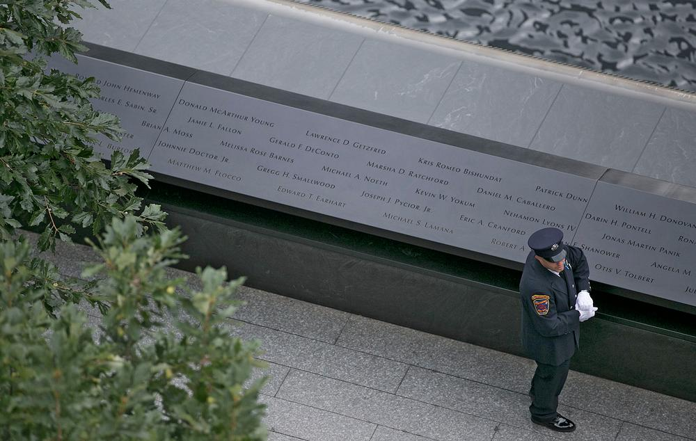 Victims' names carved around the edges of two acre-sized waterfall pools at the Memorial Plaza / PHOTO: © JIN LEE