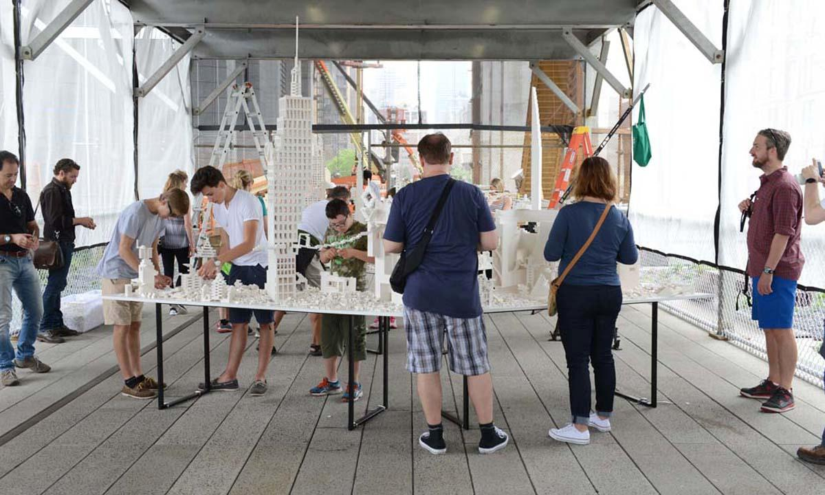 Visitors to the High Line are invited to play with the installation, building and rebuilding the structures over time / Timothy Schenck