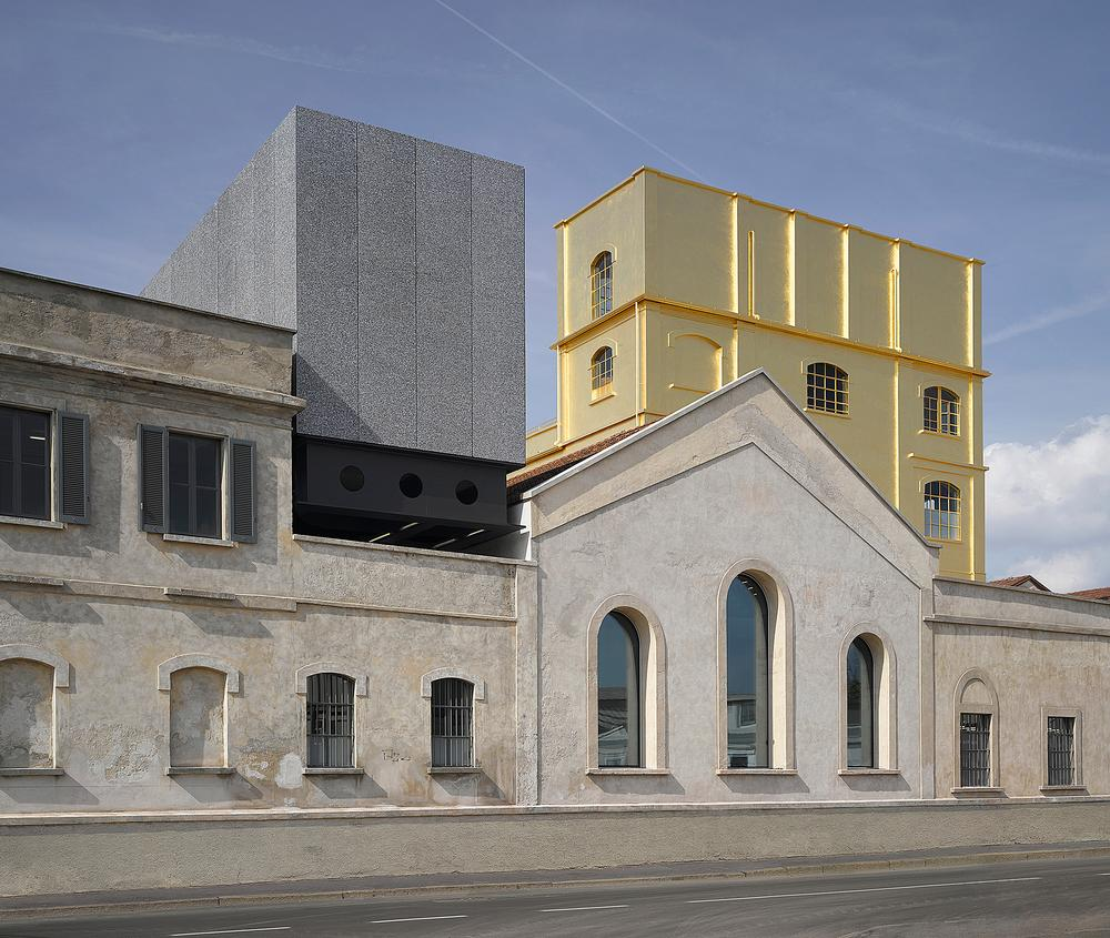 OMA restored old factory buildings and warehouses to create the Fondazione Prada. / Photos: Charlie Koolhaas