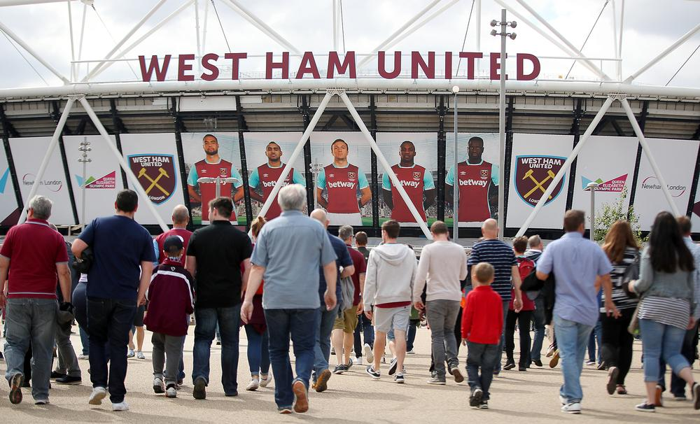 Fans walk to the stadium via its spacious surroundings in a far cry from the tight streets around Upton Park / image ©: nick potts / press association