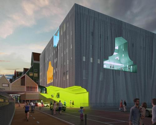 MVRDV have designed a cubic volume with variously coloured silhouettes of traditional Zaan houses carved into the exterior walls / MVRDV