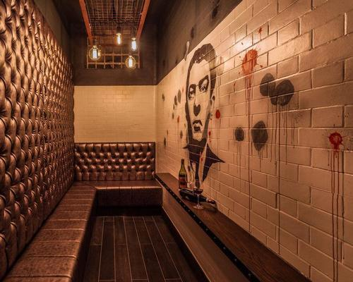 Three of the courthouse's 5ft x 15ft cells have been preserved and transformed into VIP booths / Courthouse Hotel Shoreditch