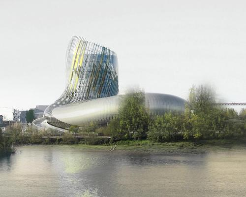 The building's curving form was designed by architects Anouk Legendre and Nicolas Desmazières to evoke both wine swirling in a glass and gnarled vines / Delphine Isart