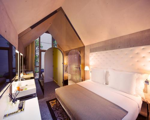 V-shaped ceilings feature in the guest rooms / M Social Singapore