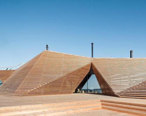 Wooden slats clad the multi-faceted, pyramid-like structure / kuvio.com