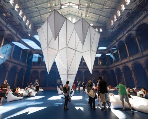 The installation at the National Building Museum makes visitors feel as though they are walking through an underwater world of ice fields
