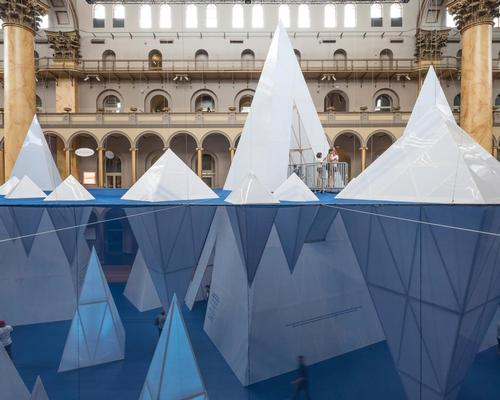 Icebergs float on a 'water line' which is suspended 20ft high bisecting the vertical space / Timothy Schenck
