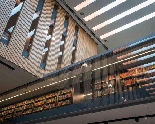 The library's glass mezzanine forms a direct visual relationship with the books / John Cairns