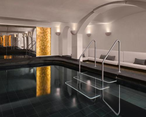 Dark lava stone tiles form the floor of the club's swimming pool, which is designed to resemble a natural pool / Will Pryce