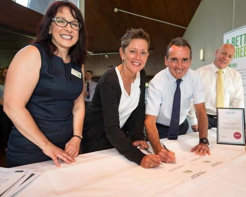 Official signing of agreement by Mark Sesnan (GLL MD), Tara Dillon (CIMSPA CEO) and witnessed by Lorraine Patrinos (GLL associate director) and Mac Cleves (GLL College head)