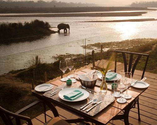 The lodge sits on the bank of the Rapti river in Chitwan National Park