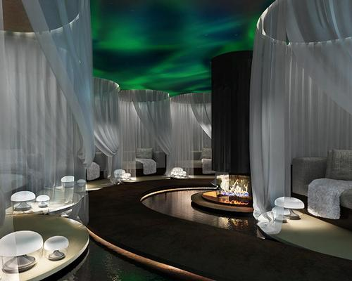 A unique relaxation room features an Aurora Borealis ceiling light feature along with relaxation pods and a faux fire