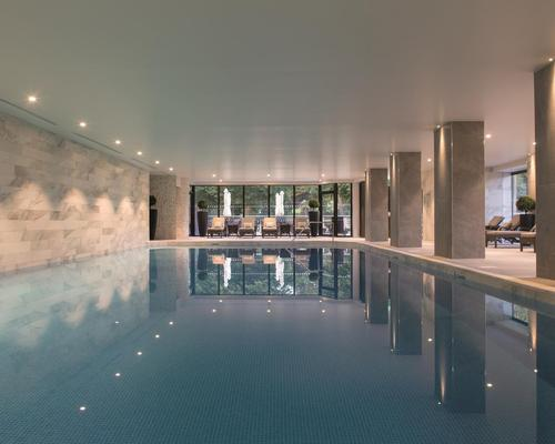 The spa includes a new indoor pool and wet area with mood LED lighting, an infinity wall, and floor-to-ceiling windows
