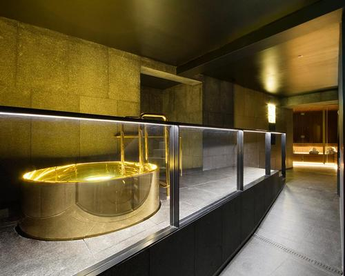 The Away Spa features a black and gold theme to represent the building's high-value former use