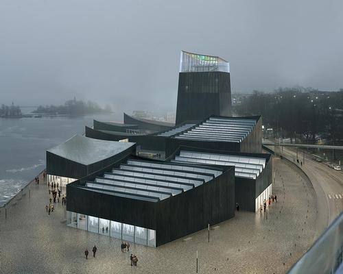 The museum design sees a series of nine linked pavilions anchored by a lighthouse-style tower. The wood and concrete structures are clad in charred timber, a traditional method of making wood fire and water resistant / Moreau Kusunok