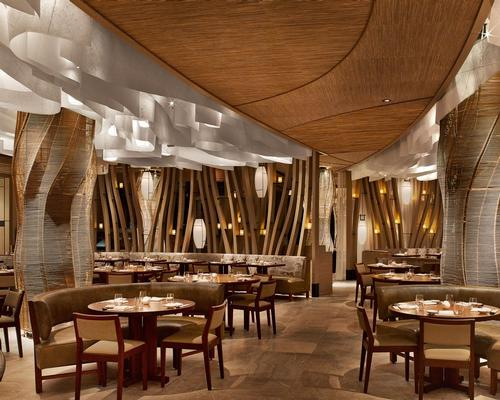 The design palette crafted by Rockwell' draws upon raw, natural forms and layers of materials such as walnut, bronze, washi paper, linen and leather' / Nobu Miami Beach
