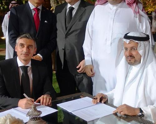 Rui Urbano, partner at Vivafit (sitting, left) signing the deal with Ithraa CEO Eid Al Shamri (sitting, right)