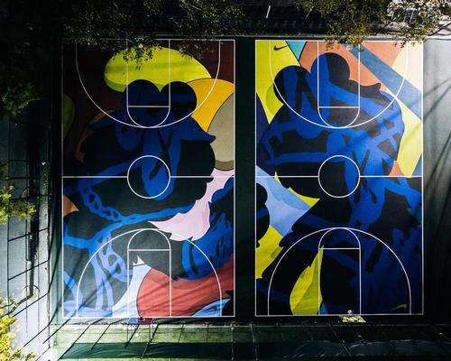 The side-by-side full courts have been painted with swirling, brightly-coloured patterns and motifs. / Nike