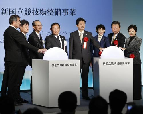 Government and city officials, and architect Kengo Kuma (far left), turn on the switch during a groundbreaking ceremony / AP/Press Association Images