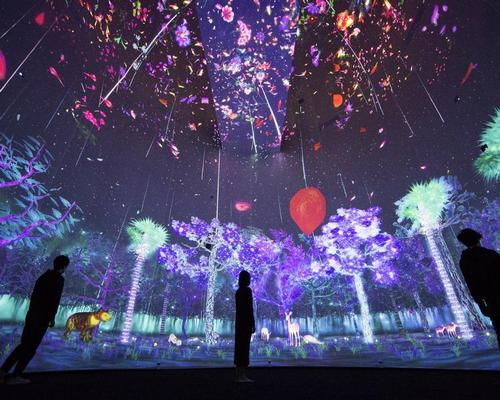 Trees grow from sprouts as people approach the interactive screen