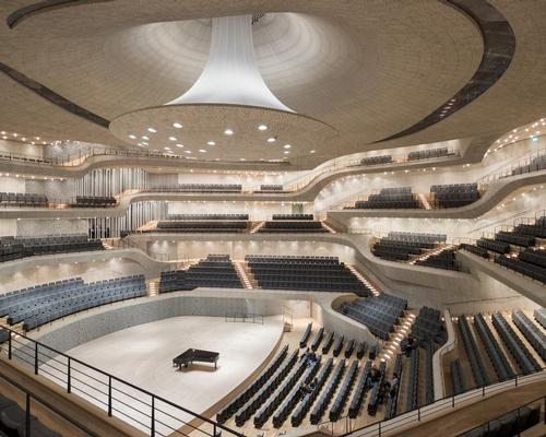The 12,500-tonne concert hall, which is housed in the heart of the glass volume, rests on 362 giant spring assemblies to decouple it from the rest of the building / Iwan Baan
